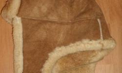 Sheep skin hat, very warm great condition. 2 same size medium. $ 30.-- each