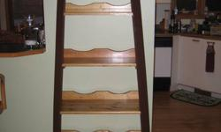 Pine shelf made with skis.  Great gift for home, ski chalet, resort, or cottage. Contact Joe (705) 789-8098 or cell (705) 783-8837