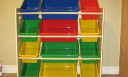 Shelf storage unit with colourful buckets to organize toys. Excellent condition from non-smoking home.