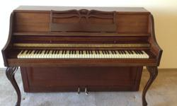Beautiful older upright piano. In great condition with lovely sound.
