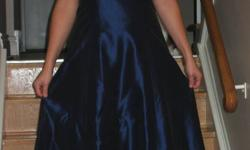 I am selling a beautiful shimmery dark blue dress for $70 OBO.  Worn once (with the exception of the pictures you see...)  This would be the perfect dress for a bridesmaid or fall wedding, or even semi formal/formal...or even Halloween! There is a