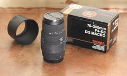 Lens mount: Canon EF  Telephoto lens, in perfect condition. Comes in original packaging with a lens hood + tripod   I am upgrading a new camera kit, so I don't need this lens now. Focal Length & Maximum Aperture 70.300mm f/4-5.6 Lens Construction 14