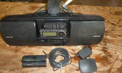 A Sirius Satellite Radio with boom box and portable docking station and remote