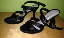 black satin straps. 4 inch heels. Only worn once.