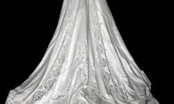 Have beautiful size 8-10 wedding gown for sale (I believe its a Prestige) with 5' train, intriciate beading on bodice, sleeves and skirt/train, also has sewn in crenoline and elastic from sleeves to fingers and on crenoline for the train.  Is valued at