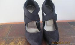 "Black shoes - 5"" heels Front elastic cross bands for comfort Excellent condition Will meet anywhere in west end (Kanata, Bells Corners, Barrhaven) Price is firm"
