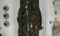 Size sm is in very good condition a couple small hole in the pocket ,The parka comes with a liner is very good condition has been boxed up for years is a bit wrinkled.  50 and 75.00 great for hunting or ranching in the winters. Keep them boys warm.