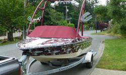 This is a 18.5' 1995 sea Ray, ski Ray true inboard direct drive tournament boat. Powered by a powerful Chevy 350 with a velvet drive. This boat can pull a very heavy rider out of the water on a deep water start in seconds. The boat has a full custom wrap