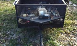 hey i have my home made built to last utility trailer up for sale its 99'' long 51'' wide it uses a 7/16 ball has a 2000lb campion winch all steel with the exp of the floor being 2x8 bords.newer tires and new cupling.pull the pin and it becomes a dump