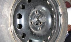 !!! NEW  PRICE  !!!   A set of four P195/60/R15/87S  M&S snow tires mounted on new steel rims.  Uniroyal Tiger Paw tires.  Rims have 4 lug nuts holes. One season of use only.  Off of a Ford Focus Available to view on request.