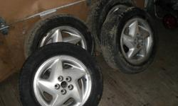 these tires are about 70% left on tread comes with aluminum rims off of 94 sun bird may fit other vehicals