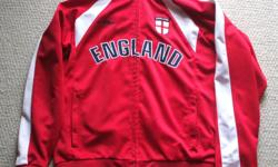 For Sale :England Jacket by Umbro. (Red and white trim)) Full front Zipper to neck - 2 front zippered pockets Sized Medium but person in pic is sz. Large. Mint condition.. $20