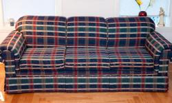"""The blue tartan couch (A) and matching armchair (B) are in good condition and to be sold as a set. The armchair does have a couple small areas of puppy chewed fabric, visible in the lower left corner of the image (B). Sofa Dimensions: 36""""D x 93""""W Chair"""