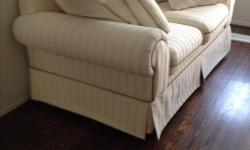Due to downsizing, we are selling sofa and love seat in excellent condition.. High quality fabric Colors: cream with taupe piping. Smoke free and pet free home