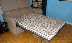 66 Inches Beige Pin Stripe Good Condition Double Bed sleeps two comfortably Mattress in good condition as well Very Comfortable couch Must Pick Up - Contact ASAP if interested Main Intersection: Oakwood/Vaughan
