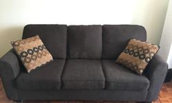 Comfy Sofa in Good shape with a Double pull out bed that has been hardly used and still has on the protective plastic on Matress