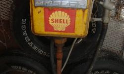 VERY HEAVY Antique Gas pump.   If you know what you are looking at, you know it is worth more...   I will sell - I have too much stuff. - offers looked at.   Come see - it is at the glass doors inside the shop - call to get access/deal. Cheers Mike. 705