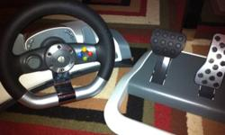 SOLD Thanks Kijiji!!! Xbox 360 steering wheel. Excellent condition, like new. Everything included: wheel, pedals, table clamp and plug. Great fun! Make a great Xmas gift. $50. Will even throw in Project Gotham Racing 3 game for free! Don't let this deal