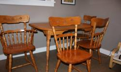Solid handmade maple set of 4 chairs and table.   Set includes 4 chairs (3 reg chairs and 1 captain's chair which has arms) and table with 2 leaves.   Each chair has engraving on back of chair (see pic below)   Table measures 35 1/2 inches by 40 inches