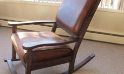 Scottish imported, solid hardwood, leather rocking chair, bought last year for $1200 but due to a move we have to sell. It would make a great nursing chair for a new mother. For Sale for $400 We cannot deliver; you must be able to pick up