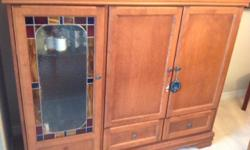 Selling solid maple cabinet/hutch with stained glass door. In excellent condition, no scratches or dents. Measures 61.5 inches wide, 24 inches deep and 51.5 inches high. It's an old TV cabinet that has been repurposed into a hutch. It has three adjustable