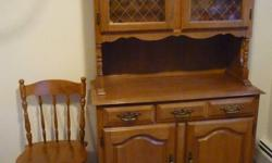 Dining table with 2 extension leaves, Total of 8 chairs, 2 chairs with arms + 6 chairs without arms plus hutch. All in excellent condition, all solid maple.