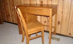 Solid maple students desk and chair.  Three side drawers and one centre.  Very good condition.