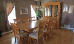 "The dining table has a centre leaf and comes with 8 chairs which includes 2 captain chairs. The fully extended table is 84"" long and 42.5"" wide. The hutch and buffet comes in 2 pieces and is 83.5"" high, 61.5"" wide and 16.5"" in depth. Excellent condition."