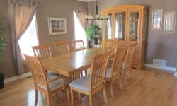 "The dining table has a centre leaf and comes with 8 chairs which includes 2 captain chairs. The fully extended table is 84"" long and 42.5"" wide. The hutch and buffet comes in 2 pieces and is 83.5"" high, 61.5"" wide and 16.5"" in depth. Excellent condition,"