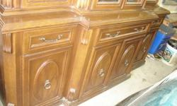 """HAVE A SOLID OAK BUFFET /HUTCH WITH GLASS DOORS AND LIGHTING INSIDE.BOTTOM HAS DRAWERS LINED IN VELVET AND CABINET DOORS. THIS IS A BEAUTIFUL  UNIT. THE """"DEMENTIONS ARE LOWER UNIT 74.5 """"LONG 32 """"HIGH 27.5"""" DEEP UPPER UNIT IS 563/4 """" HIGH 69.5"""" LONG AND"""