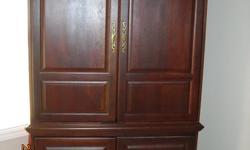 """Large solid wood armoire to hold standard 32"""" TV,  Measures 45"""" wide x 23"""" deep x 82"""" high.  Could be converted to have shelves (extras not included) or wardrobe, does not include bar (around $10) shelf between upper and lower doors is fixed, so not"""