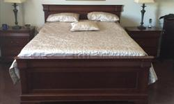 solid wood mint condition 8 drawer dresser with mirror+ 2 door Armoir Dresser +2 night tables+bed with head board and footboard with bed plank. Must see. Moving and no room for items. Priced to sell. First come first serve .Purchased for 6800$.