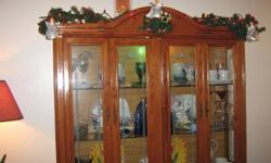China Cabinet with hutch and light inside to display all the fine china. Cabinet has 4 doors underneath.  $325 OBO. Excellent for Christmas! Dinning set table with 6 chairs, Green soft velvety covers, hard wood chair, excellent shape. $325 for table and