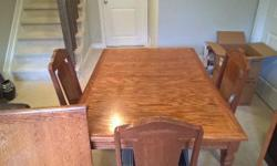 "Solid wood dining room table and 4 chairs The table is 54"" x 38"" plus an insert 18"" x 38"" The chairs have a cushion seat asking $130 obo"