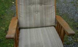 solid wood rocker glider with cushions  antique style.  call 604 858 6955