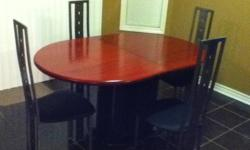 $ 125 o.b.o. MODERN LOOK HARDWOOD TABLE AND 4 METAL CHAIRS FOR SALE. EXCELLANT CONDITION AND WILL LAST. THIS DINETTE SET IS MADE TO LAST. MUST BE SEEN IN PERSON TO REALLY APPRECIATE.