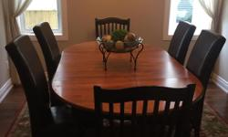 """Excellent condition solid wood table with 2 leaves, breaks down to a circle. See pictures of table. Comes with 8 chairs, 4 leather 4 wooden. Table is 42"""" when its a circle. Table and chairs have been well taken care of. If the add is still up its still"""