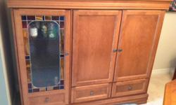 Selling solid wooden cabinet/hutch with stained glass door. In excellent condition, no scratches or dents. Measures 61.5 inches wide, 24 inches deep and 51.5 inches high. It's a TV cabinet that can easily be repurposed into a hutch or storage unit. It has