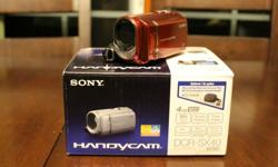"""Sony camcorder, 4GB internal memory  and includes an extra 4GB memory stick, 3.0"""" touchscreen, 60 x optical zoom.  In excellent condition, never really used it."""