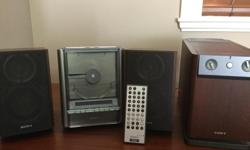SONY Micro Hi-Fi CD System , excellent condition . Hardly been used , works great . Just making space as it never gets used . CD player , radio , sub woofer and 2 speakers , remote . Manuel included . 8.5 H , CD is 6.5 W speakers are 5' W , woofer is 6W.
