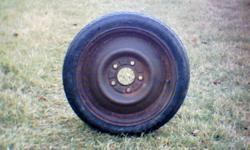 One Temporary Spare Compact Tire Size T125/70 D15 Mounted On 5 Bolt Rim.