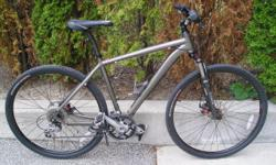 "Specialized CrossTrail Expert Mountain Hybrid 52 cm (equivalent) 27-speed with RST Vogue Comp fork, 27-speed (9 x 3) Deore indexed, disc brakes front & rear rides and looks almost as new good for riders from 5'5"" to almost 6' $750"