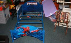 Toddler Bed (no mattress) 4 piece bedding set - comforter, fitted sheet, top sheet, pillowcase Set of panel curtains 2 Wooden Chairs Wooden toy shelf with 9 red toy bins Rug Spiderman reusable bag with spiderman soft football and soft round ball Spiderman