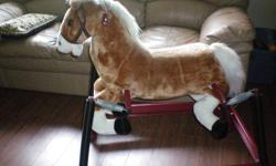 Barely used, spring horse, when you push its ear it makes horse noise, it wags its tail and it moves its mouth.  Great toy!
