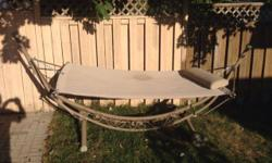 Stand alone steel frame hammock. Perfect for the back yard or the cottage.