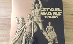 Star Wars Trilogy - Episode 4 / 5 / 6 Full Sreen Edition DVD's Includes bonus materials disc DVD's, Box, and inner sleeve box all in excellent condition *if the ad is still posted, the item is still available*