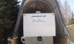 "For Sale 2002 Starcraft fifth wheel ready for florida! stored in covered RV storage never had snow on. Better than average condition 2 slide outs, Trailer in Thunder Bay. Living room at back model "" NO BUNKS"" Make reasonable offer."