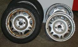 FOUR STEEL WHEELS AND TWO WINTER TIRES FOR SMART CAR I AM ASKING 200.00 FOR THE SET OBO CALL 705-737-5385 BEFORE 6PM OR AFTER 7PM CALL 331-3411 ASK FOR DENNIS