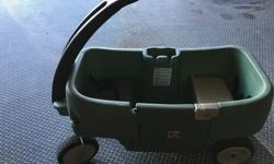 Our kids have outgrown the wagon. In good condition. Cup holder and seat belts. Located in the village of Carp.