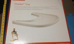 White Stokke Tray table for Stoke chair for sale. Original packaging included. It was used for one child and always kept exceptionally clean. A great deal for half the price of a new one.